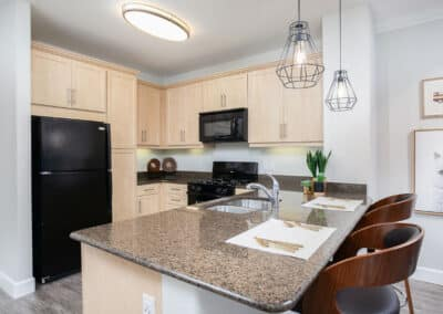 spacious kitchen with black stainless appliances